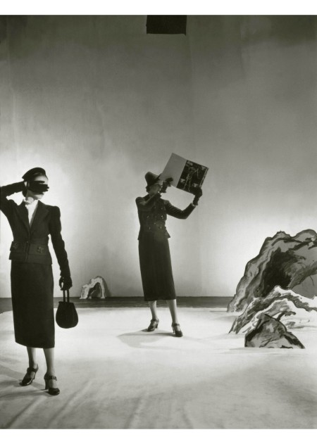 Models wear Schiaparelli clothing and hold an issue of Minotaure, a Surrealist magazine with a cover designed by Salvador Dalí Vogue, 1936 © Cecil Beaton