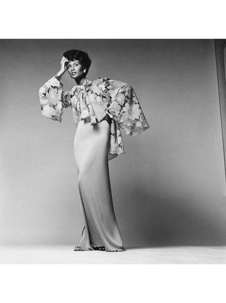 Beverly Johnson wearing a long fitted tube dress and floral print chiffon tie-jacket with wide sleeves by Stephen Burrows Vogue 1974 © Francesco Scavullo