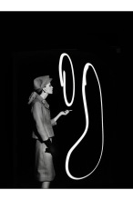 Dorothy blowing light smoke rings, Paris 1962