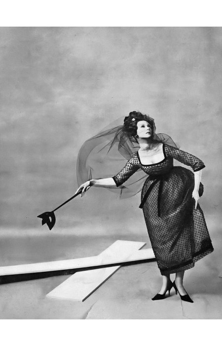 Dovima in jet-embroidered black point d'esprit ribboned in velvet under the bosom and belled over pale blue tulle by YSL for Dior, shoes by Vivier, photo by Richard Avedon, Harper's Baza