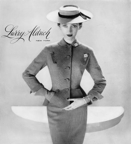 Dovima in pink yarn-dyed worsted suit by Larry Aldrich, hat by Mr. John, photo by Richard Avedon, Harper's Bazaar, January 1951
