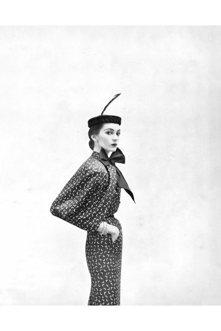 Dovima in silk print ensemble by Adele Simpson for B. Altman & Co. Harper's Bazaar, February 1951 © Richard Avedon