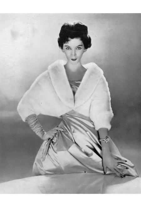Dovima in white mink jacket from Bergdorf Goodman, Vogue, December 1, 1954 © Richard Avedon