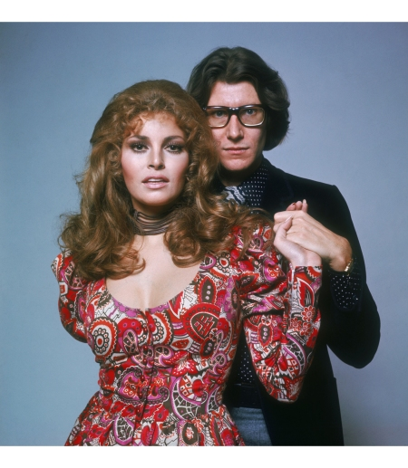 French fashion designer Yves Saint Laurent (1936 - 2008) with American actress Raquel Welch, circa 1975. © Terry O'Neill