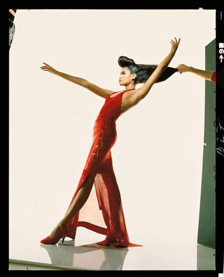 Gail O'Neal wearing a red Alaïa acetate knit halter and corset-strapped skirt, 1986 © Patrick Demarchelier