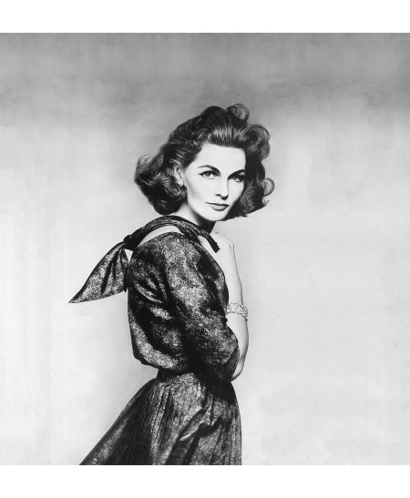 Georgia Hamilton in brown and black silk print dress with loosely knotted scarf-collar and pleated skirt by Larry Aldrich, photo by Richard Avedon, Harper's Bazaar, March 1956