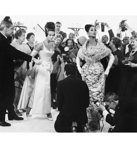 Margot McKendry And China Machado With Members Of The French Press, Paris Studio, August 24, 1961 Dresses by Lanvin-Castillo and Heim © Richard Avedon