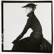 Model wearing black dress with wide pleated sash at waist, tied at back, c. 1951 c