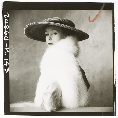 Model wearing large brimmed hat and white fur stole, August 6, 1949 b