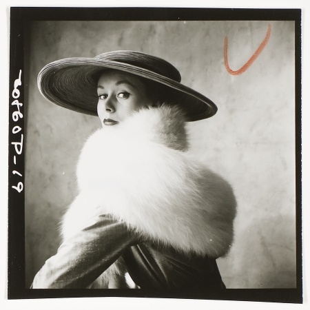 Model wearing large brimmed hat and white fur stole, August 6, 1949