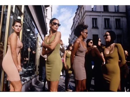 Models in Alaïa dresses outside one of the designer's Paris Fashion Week shows 1986