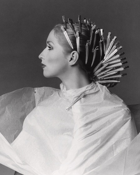 Portrait of Chris Royer with hair clips in her hair in preparation for a new hairstyle by Dina Azzolini march 1975