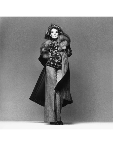 Rene Russo wearing an Ungaro ensemble of a long, woven-striped alpaca coat with fox collar, printed challis blazer with matching crepe de chine shirt and wide-leg tweed pants; hairstyle