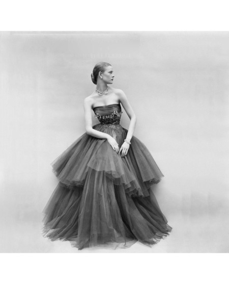 Susan Abraham in a chiffon and tulle tiered evening gown with bead work on the bodice Vogue September 1951 © Don Honeyman