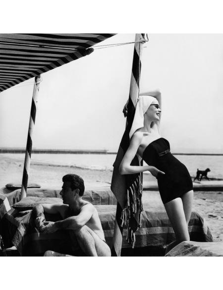 Susan Abraham in black maillot Vogue UK, July 1956 ©