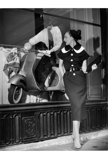A model dressed in Schiaparelli in front of the Schiaparelli boutique, 1954