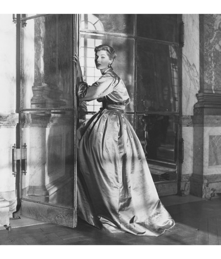 Fiona Campbell-Walter in luxurious gold Duchesse satin gown by Jacques Fath at the Hall of Mirrors, Versailles Vogue, October 1952 © Frances McLaughlin-Gill b