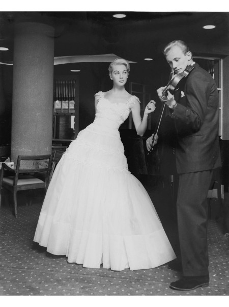 Janice Wakely in white Hartnell gown with man playing violin, © Athol Shmith, Melbourne, Victoria, Australia, 1966