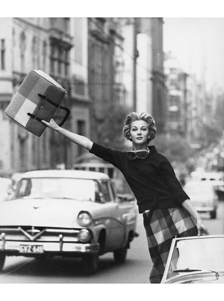 Janice Wakely reaching out from a vehicle on Queen Street, Melbourne © Hemut Newton