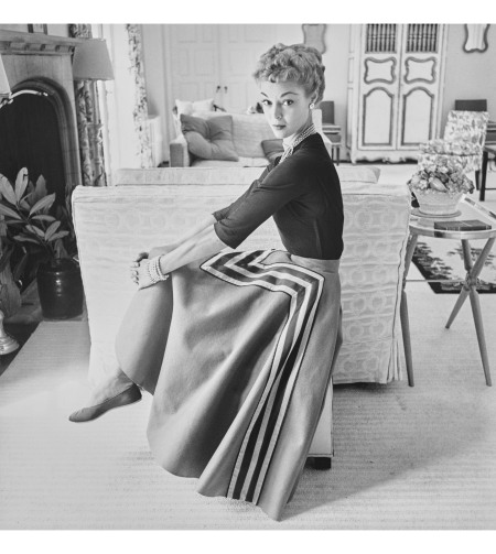 Jean Patchett in blouse and full felt skirt appliqued with brown and white stripes by Melrod Ritter Vogue, Ocotber 15, 1951 © John Rawlings