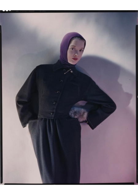 Model wearing brown tweed suit, a Townley design, with dyed fox mittens and jersey headdres Vogue 1945 © Erwin Blumenfeld