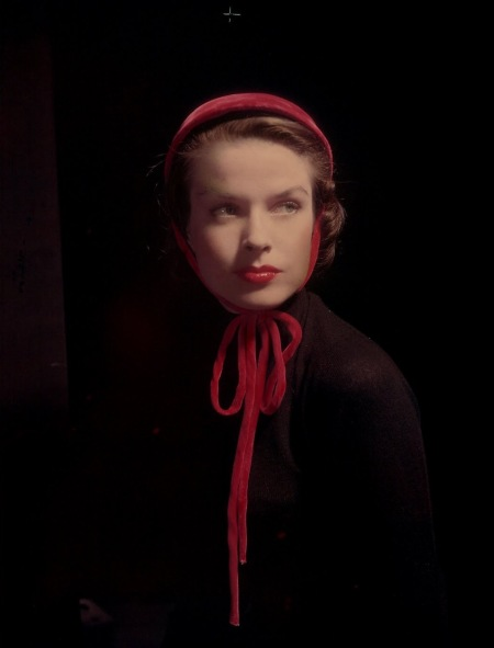 Model wearing small red velvet cap tied under chin 1948