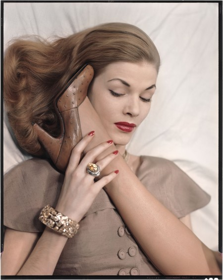 Model with ostrich opera pump, by Newton Elkin, along side her face, comparing it's light brown color to that of her hair Vogue 1949 © Erwin Blumenfeld