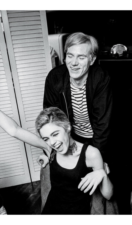 Sedgwick and Warhol at a dinner party in N.Y.C., 1965 © Bob Adelman