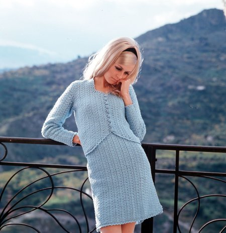 Twiggy wearing a fashionable blue knitted cardigan and skirt, as she poses on a balcony (Photo by Popperfoto:Getty Images)