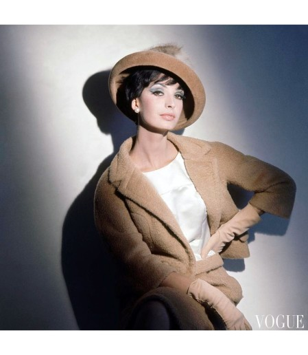 A model wearing a camel wool suit and matching hat by Galanos Vogue Oct 1961 ©