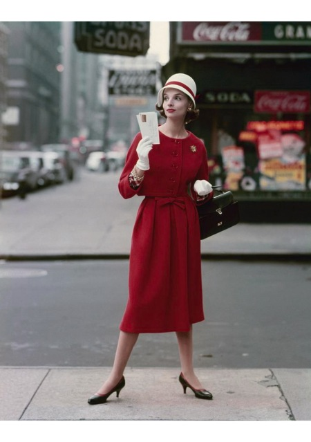 A model wearing a cropped red wool jacket and matching skirt by Jeanne Campbell for Sportwhirl feb 1958 © Sante Forlano