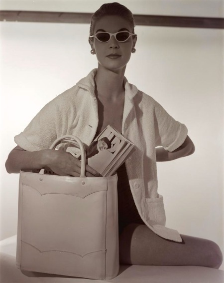 A model wearing a Jantzen cardigan and Meyrowitz sunglasses with a Josef bag Jan 1954 © Horst P.Horst