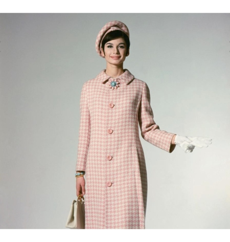 A model wearing a pink and white hounds tooth coat by Jacques Helm Glam feb 1963 © William Connors