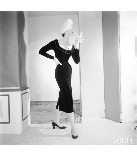 A model wearing a velvet Harvey Berin dress with a John Frederics hat. Sept 1953