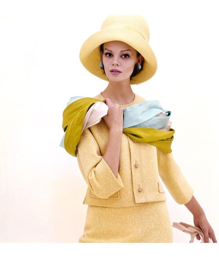 A model wearing a yellow suit and hat by Finger, Rabner and Jontow March 1961 © Sante Forlano