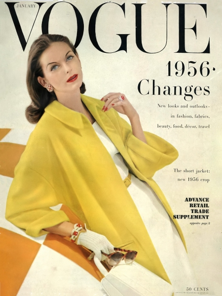 Anne St. Marie in yellow wool fleece coat by Originala over a white linen dress by Ben Barrack, coral jewelry by David Webb, cover by Frances McLaughlin, Vogue, January 1956