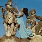Benedetta Model standing between statues at the Villa Palagonia, Bagheria, Sicily dec 1967