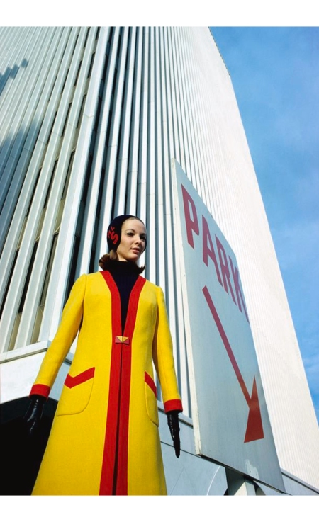 Boeing Company employee Mary Louise wearing a yellow and red coat at the Seattle World Fair Glam feb 1966 © William Connors
