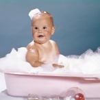 1960s SMILING BABY SITTING...