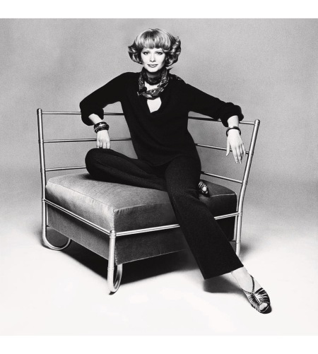 Charly Stember sitting on a chair wearing a cowl-neck sweater aug 1974