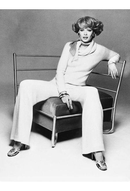 Charly Stember wearing an oversize pullover and matching wide-leg, pull-on pants by Bonnie Cashin, with a neck scarf by Bottega Veneta and sandals by Givenchy aug 1974