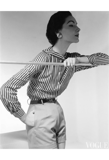 Cherry Nelms model holding a railing wearing a Nelly de Grab shirt and shorts with Mosell earrings Jan 1954 © Horst P. Horst