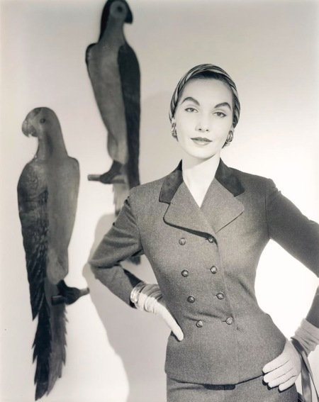 Cherry Nelms model wearing a suit with birds painted on a wall. Aug 1953
