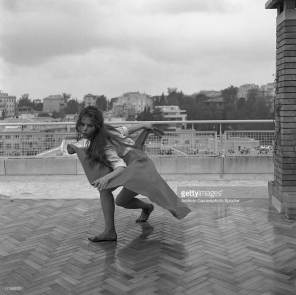 Claudia Cardinale, wearing a shirt and a wide skirt, dancing barefoot on a roof terrace in Rome, 1959. (Photo by Archivio Cameraphoto Epoche:Getty Images) a