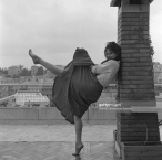 Claudia Cardinale, wearing a shirt and a wide skirt, dancing barefoot on a roof terrace in Rome, 1959. (Photo by Archivio Cameraphoto Epoche:Getty Images) c