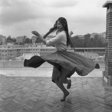 Claudia Cardinale, wearing a shirt and a wide skirt, dancing barefoot on a roof terrace in Rome, 1959. (Photo by Archivio Cameraphoto Epoche:Getty Images)