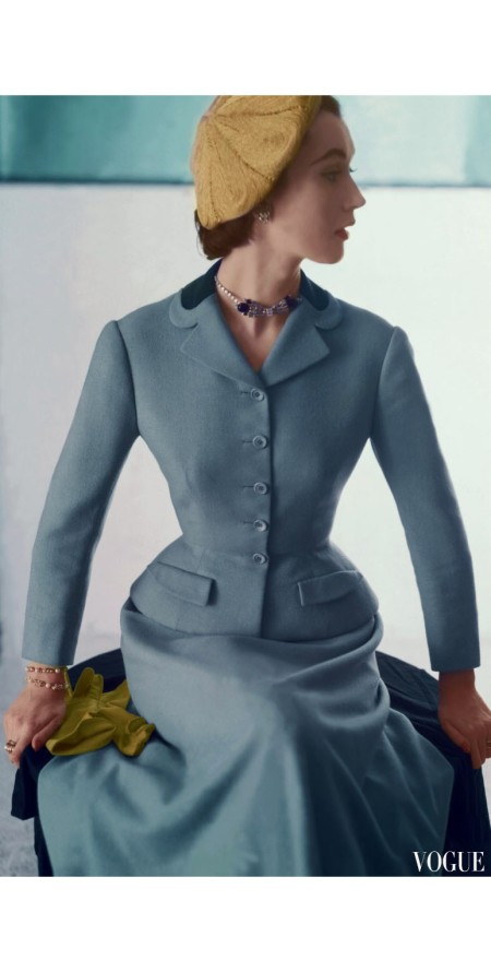 Dovima with head turned to side wearing suit by Hattie Carnegie in aquamarine blue wool with a sapphire velvet collar and hat, a toast beret horst-p-horst-vogue-february-1952