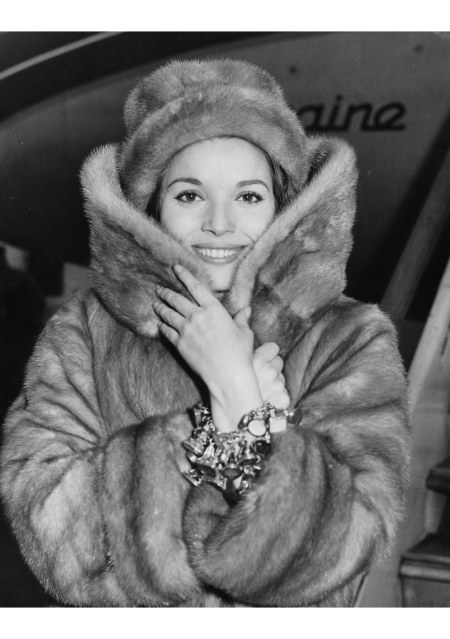Elsa Martinelli wearing a fur coat and hat, soon to star in the film 'The VIP's', arriving at London Airport, February 16th 1963 © J.Wilds