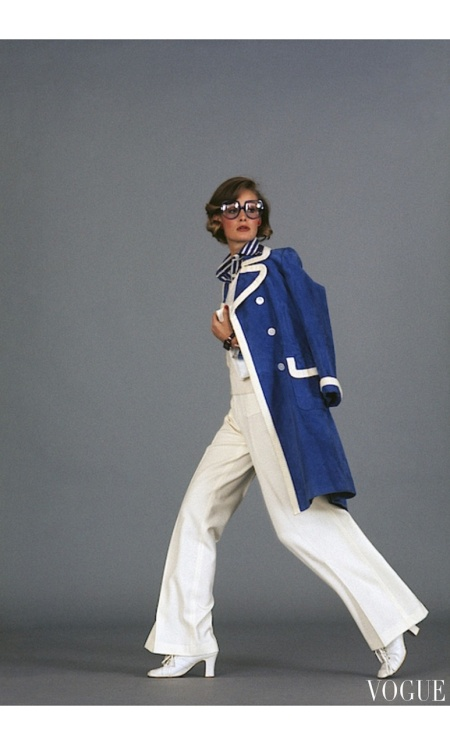 Emanuelle, Susan Schoenberg Model wearing a Valintino Boutique ensemble with Bausch & Lomb glasses July 1975
