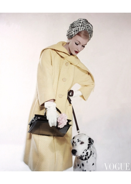 Evelyn Tripp wearing a scarf collared coat by Matlin with a Dalmatian March 1959
